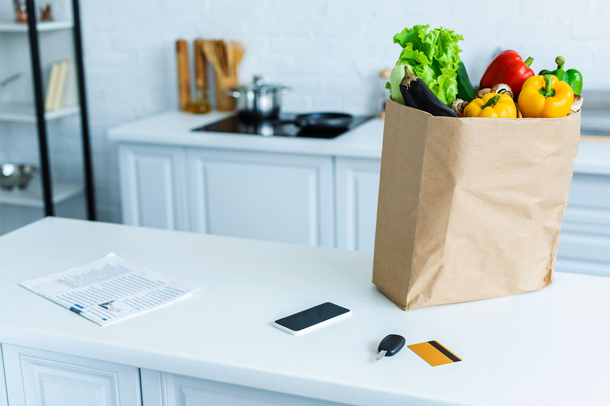 Grocery Bag of Produce on Kitchen Counter